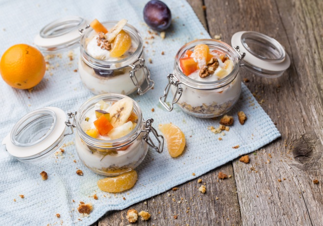 Healthy breakfast overnight oats with fresh fruit in a glass jar