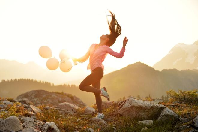 A Girl dancing at sunrise on Artist Point, Mt. Baker, Washington